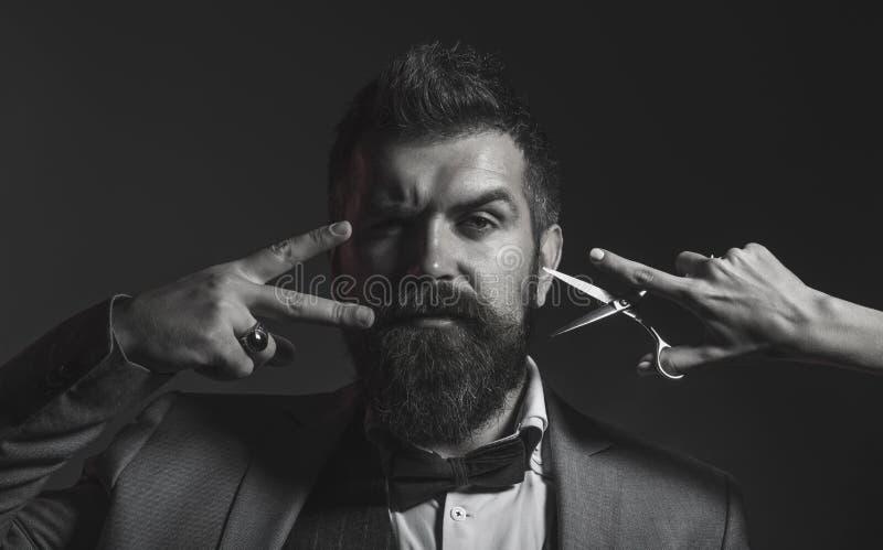 Portrait of stylish man beard. Bearded man, bearded male. Barber scissors, barber shop. Vintage barbershop, shaving royalty free stock images