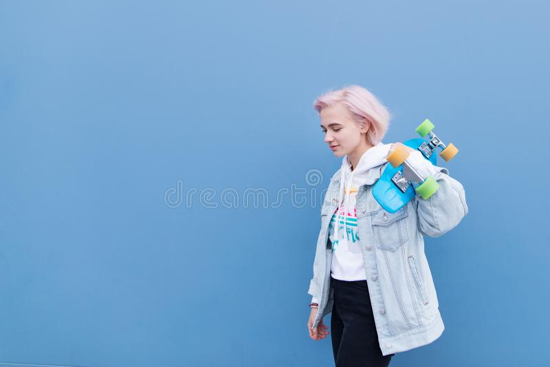 Portrait of a stylish teens girl on a turquoise background stock images