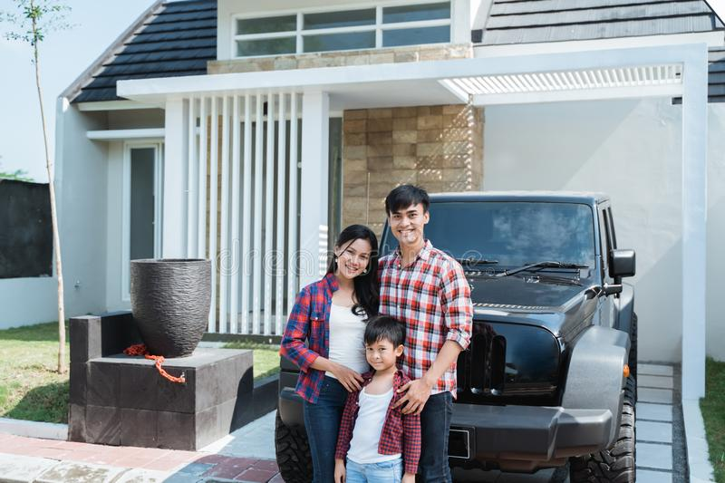 Asian family having their own new home and car royalty free stock photography
