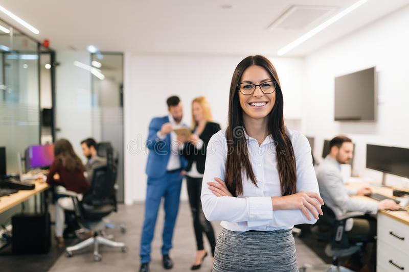 Portrait of successful beautiful businesswoman in office stock images