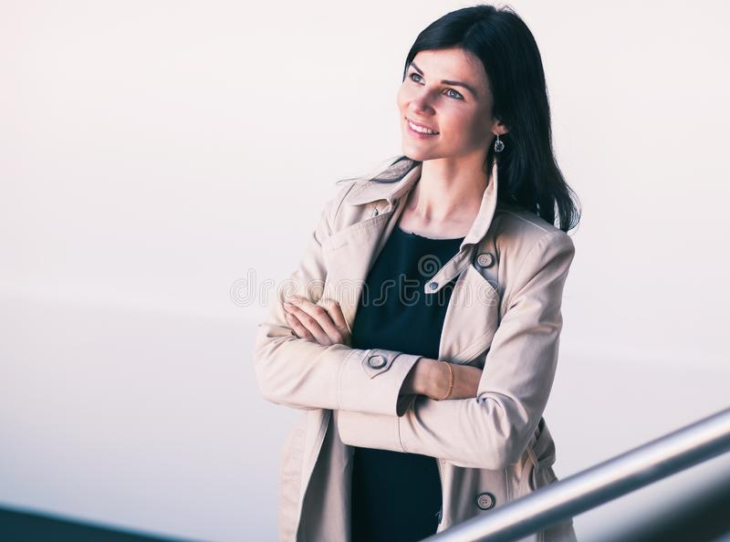 Portrait of successful business woman on a light office background stock photography