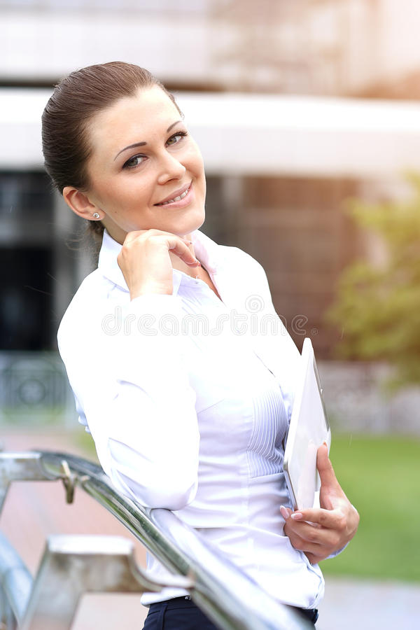 Portrait of a successful business woman smiling. Beautiful young female executive. In an urban setting stock images