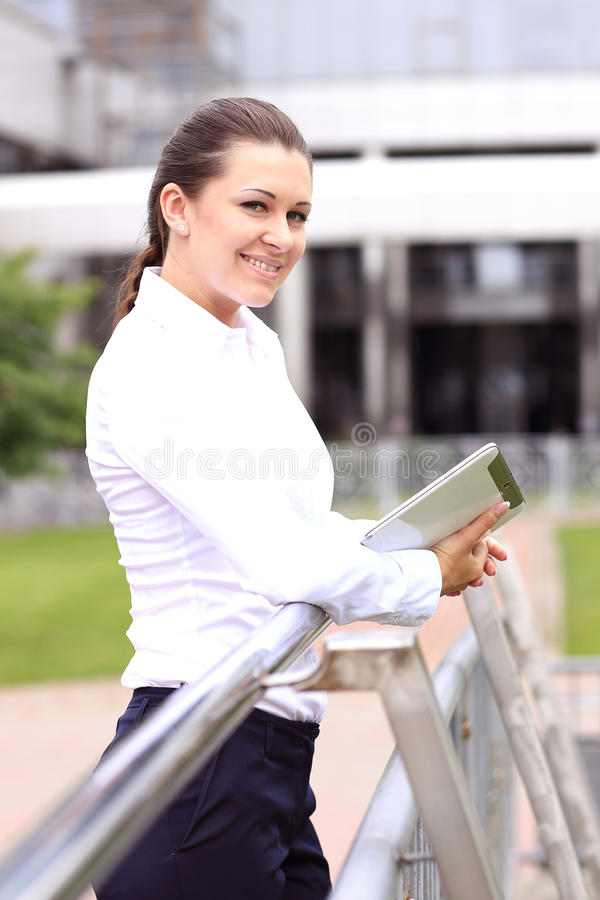Portrait of a successful business woman smiling. Beautiful young female executive. In an urban setting royalty free stock photos