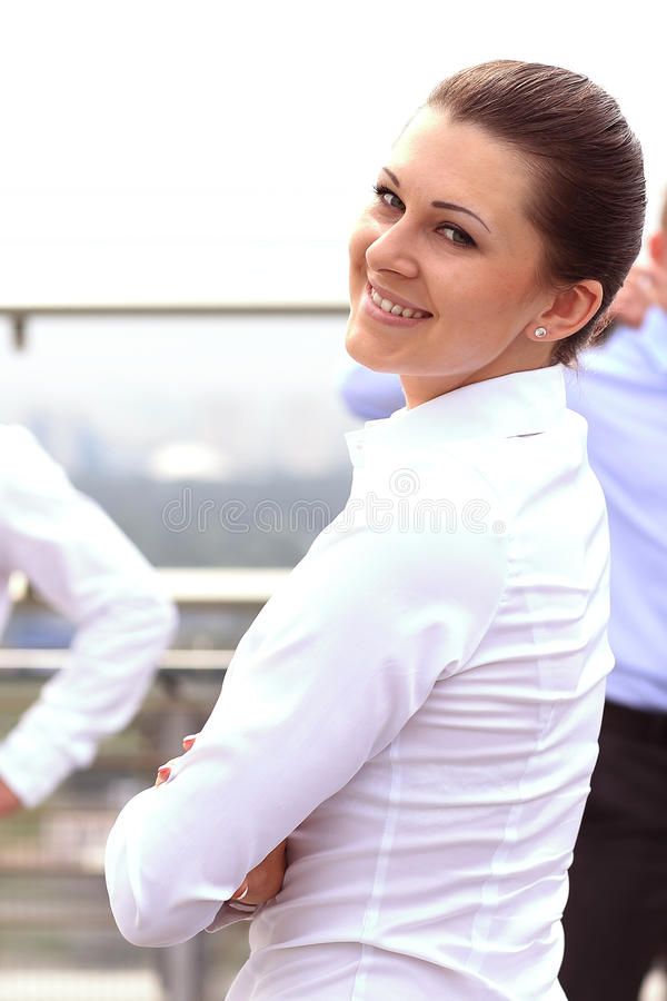 Portrait of a successful business woman smiling. Beautiful young female executive. In an urban setting stock photo