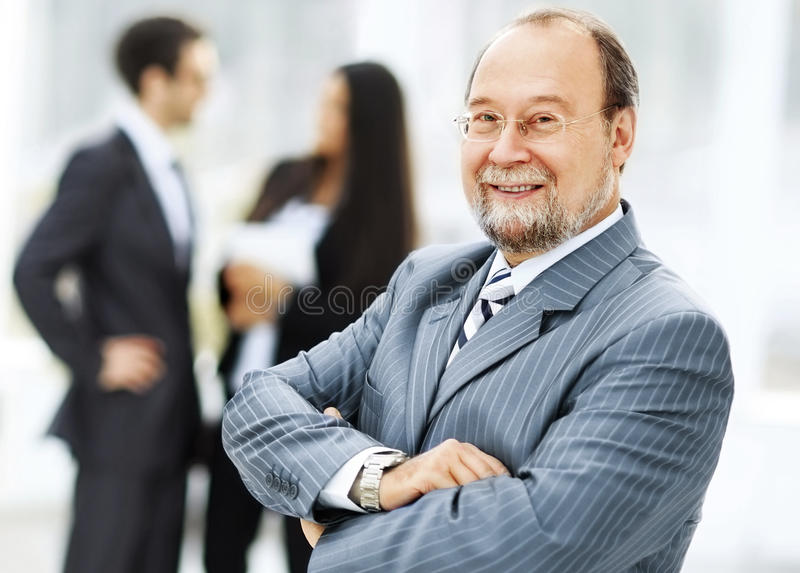 Portrait of a successful businessman on the background of the work of his team royalty free stock photo