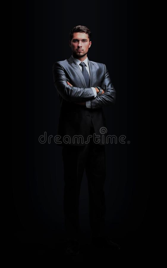 Portrait of successful businessman on black backgro royalty free stock photography