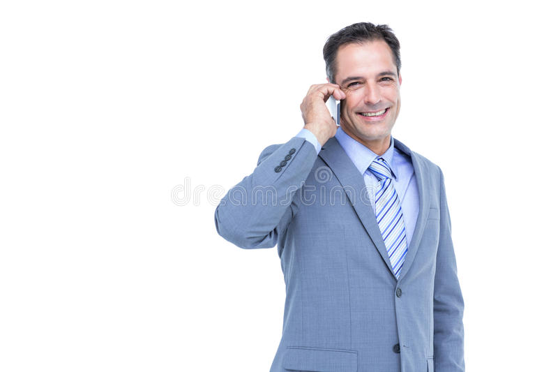 Portrait of a successful businessman on phone against white. Background royalty free stock photos