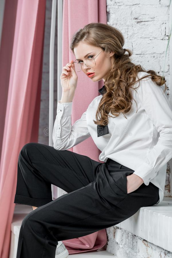 portrait of successful businesswoman in glasses sitting stock images