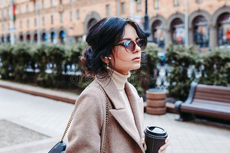 Portrait of successful businesswoman holding cup of coffee In hand on her way to work stock photos