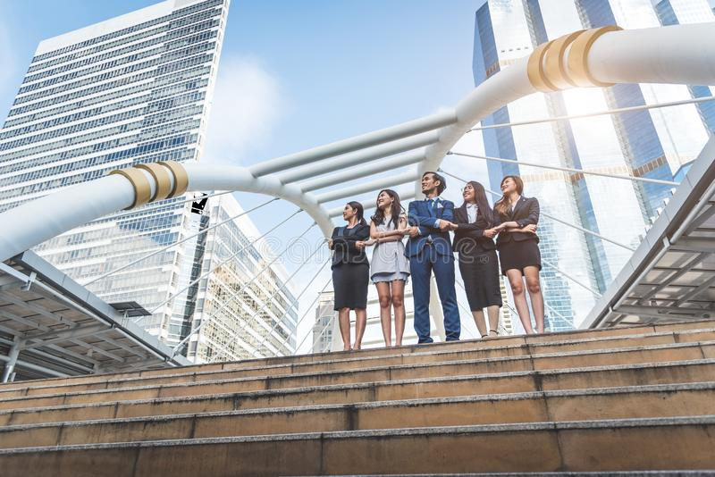 Portrait of successful group of business people looking up to sk stock image