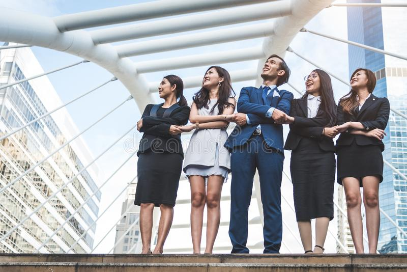 Portrait of successful group of business people looking up to sk stock photo