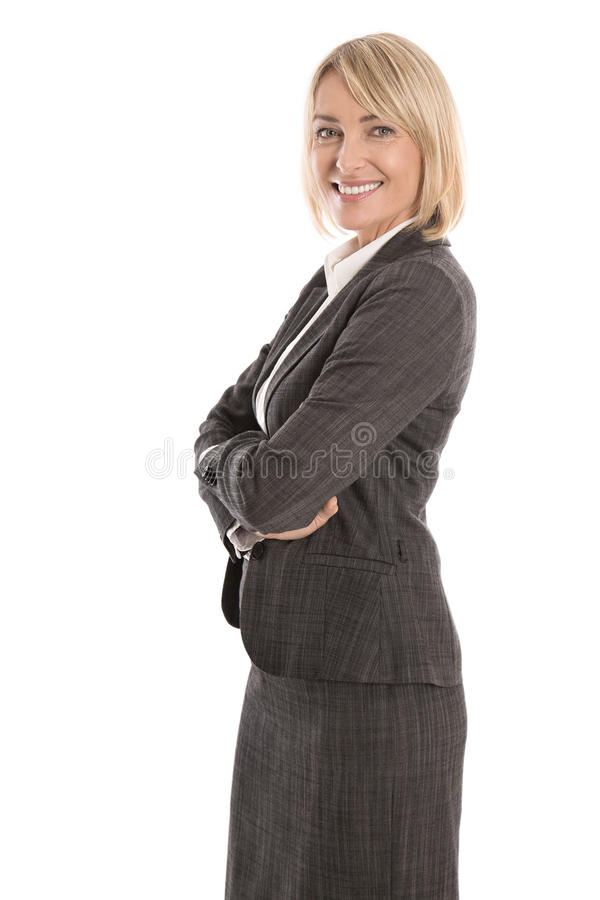 Portrait: Successful isolated older or mature blond businesswoman in blazer and white blouse. Portrait: Successful isolated older or mature blond business woman stock images