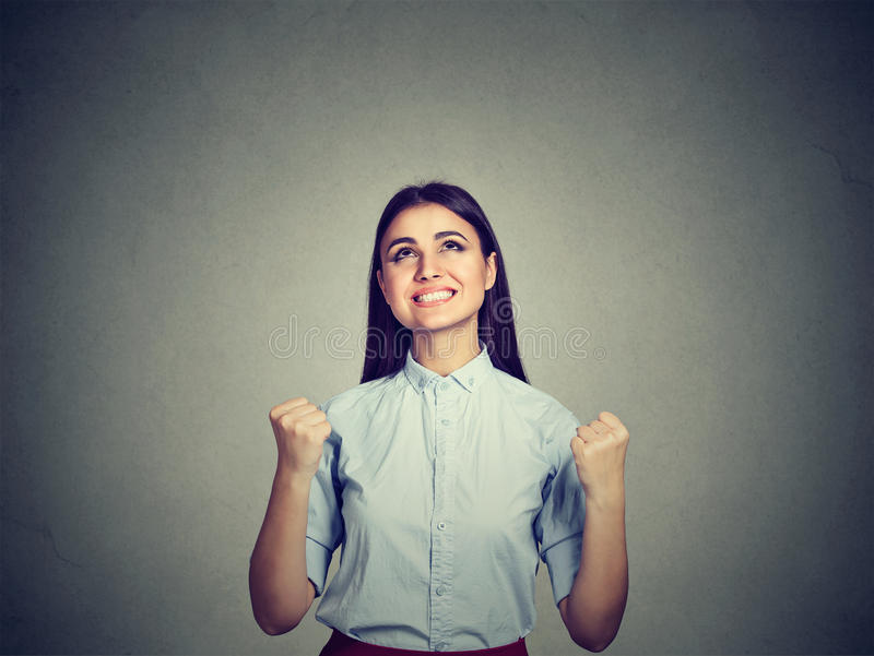Portrait of a successful woman with fists pumped celebrating success stock photography