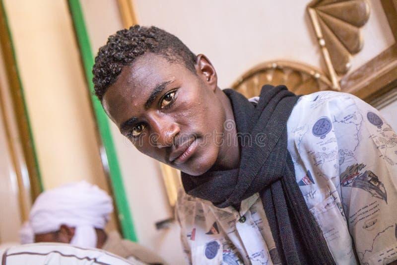 Portrait of a Sudanese man praying. stock image