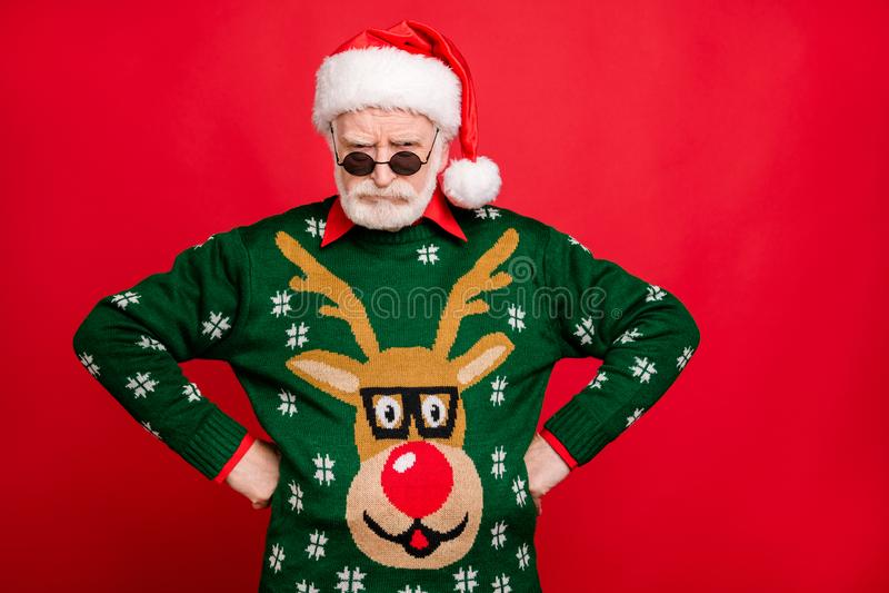 Portrait sullen frown grumpy grey hair old man in black spectacles santa claus headwear scold naughty kids on x-mas. Newyear, celebration wear antler deer stock photo