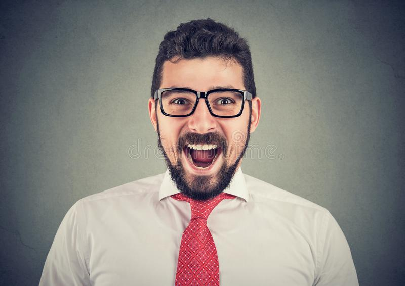 Portrait of super excited surprised business man royalty free stock images