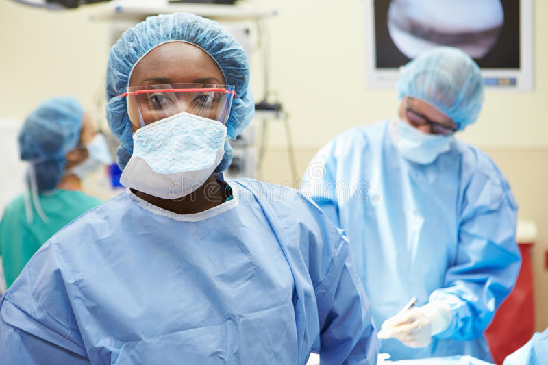 Portrait Of Surgeon Working In Operating Theatre. Wearing Protective Scrubs Looking At Camera royalty free stock photography