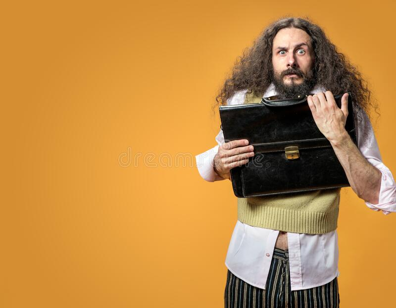 Portrait of the surprise geek holding a briefcase stock images