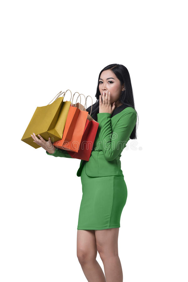 Portrait of surprised asian business woman holding in her hands stock photos