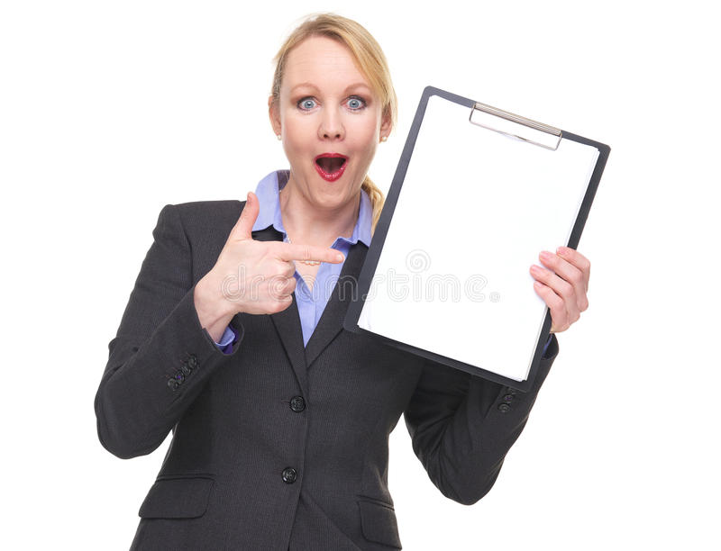 Portrait of a surprised business woman showing empty sign clipboard. Isolated on white royalty free stock photography