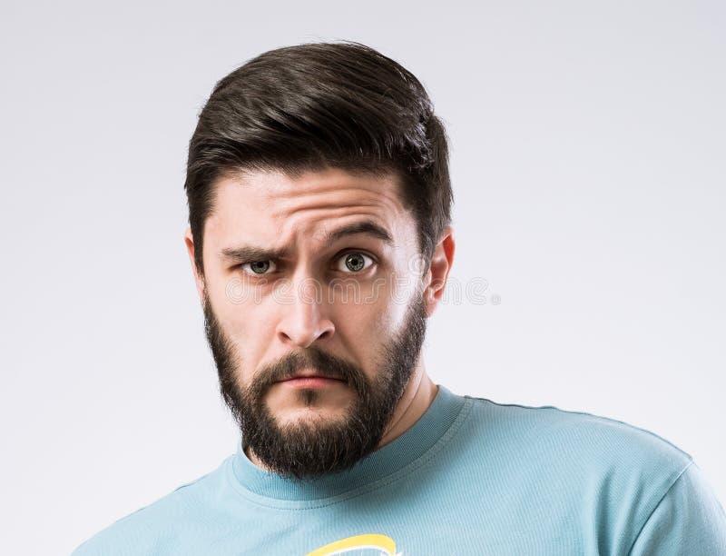 Bearded man portrait. Portrait of surprised doubtful bearded man stock images