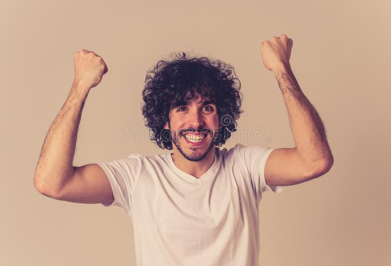 Portrait of surprised and happy man celebrating victory and winning lottery in human emotions stock photography