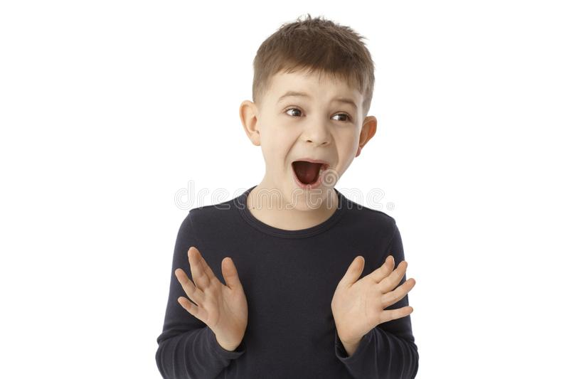 Portrait of surprised little boy stock photo