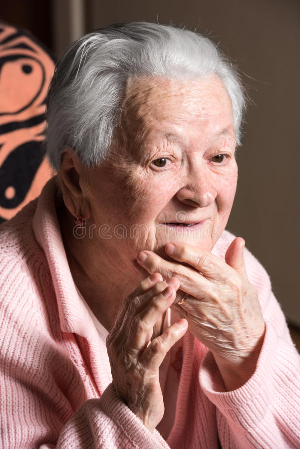 Portrait of surprised old woman. At home stock images