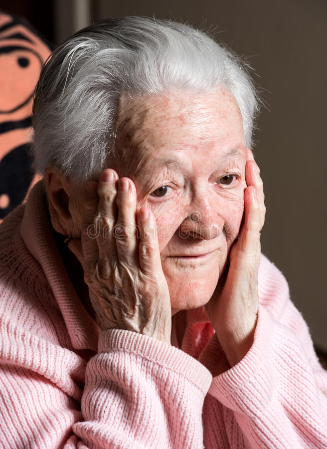 Portrait of surprised old woman. At home royalty free stock photo
