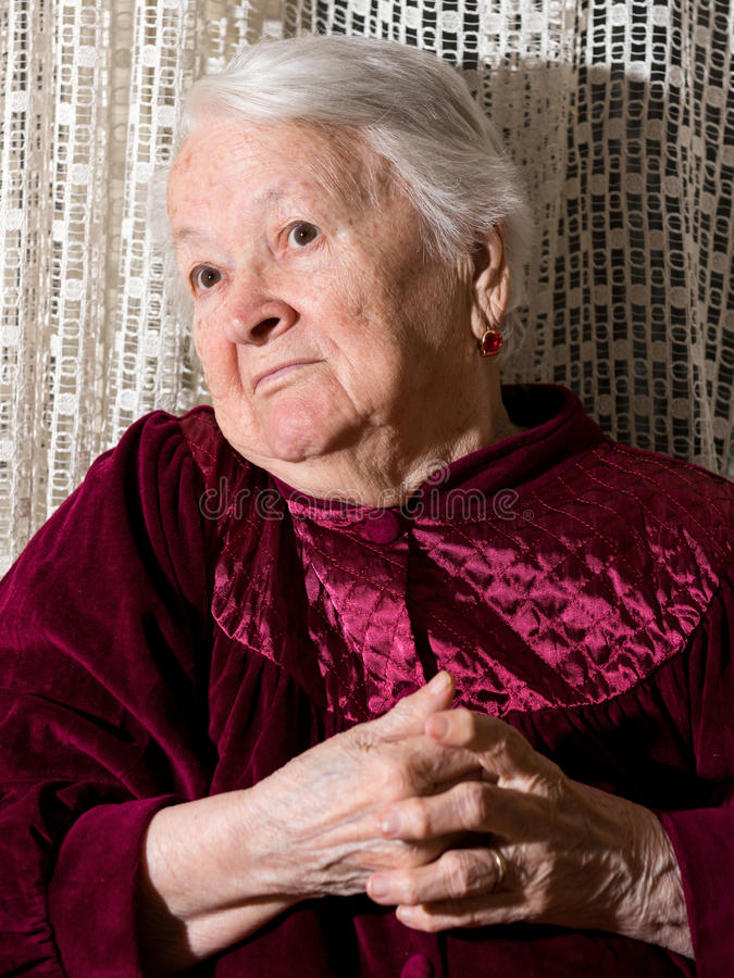 Portrait of surprised old woman. At home royalty free stock photography