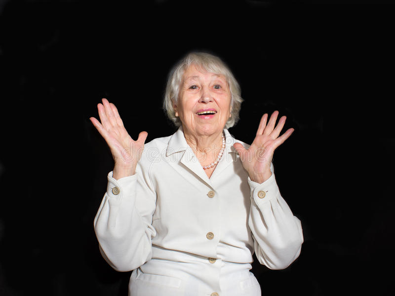 The portrait of a surprised old woman. With open mouth on black royalty free stock photography
