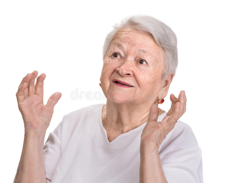 Portrait of surprised old woman. On a white background stock photos