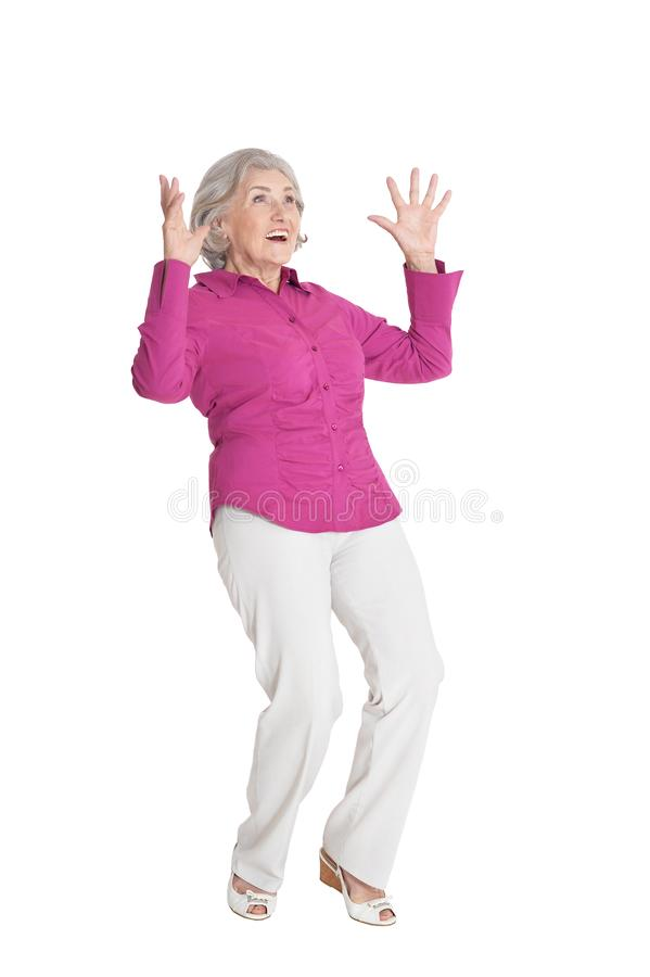 Portrait of surprised senior woman posing isolated on white background royalty free stock image