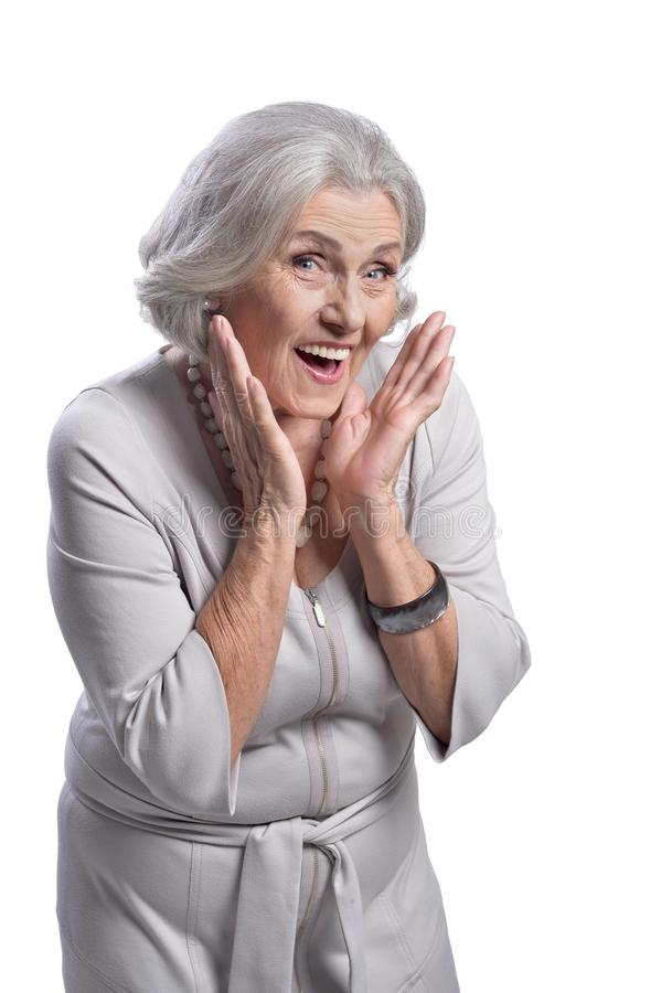Portrait of surprised senior woman on white background. Portrait of surprised senior woman posing isolated on white background royalty free stock photography