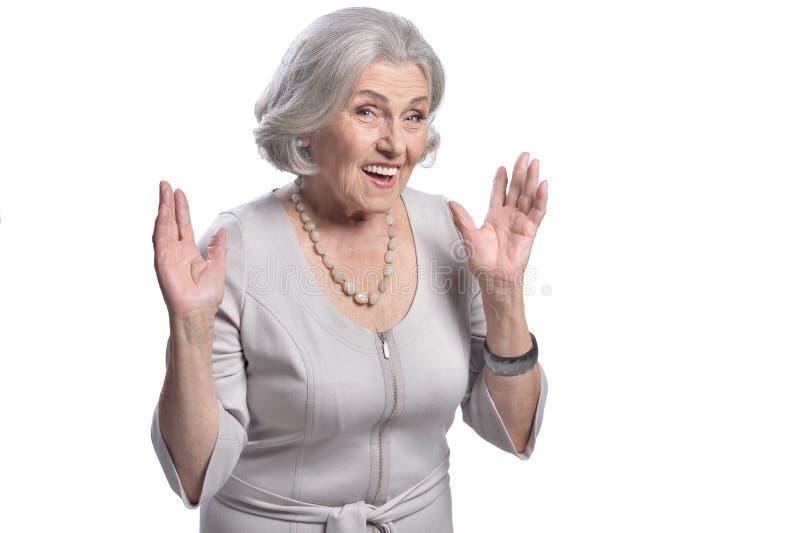 Portrait of surprised senior woman posing on white background. Portrait of surprised senior woman posing isolated on white background stock image