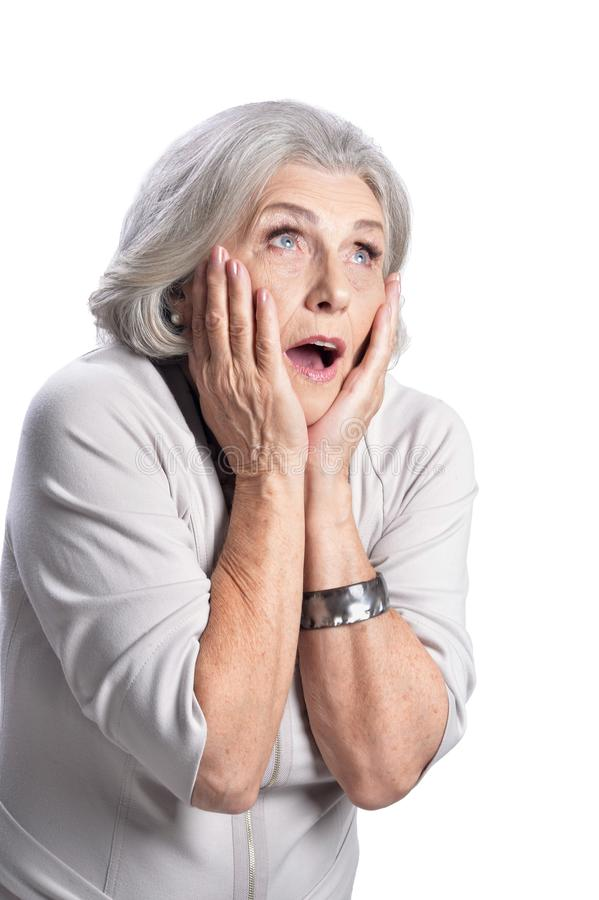 Portrait of surprised senior woman on white background. Portrait of surprised senior woman posing isolated on white background stock photography