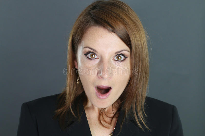 Portrait of a surprised woman. Over a gray background royalty free stock image