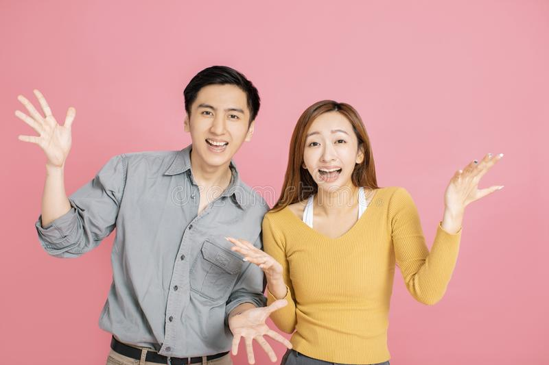 Portrait of  surprised  young couple standing together royalty free stock photos