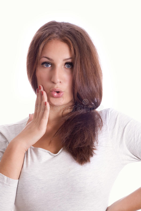 Portrait of a surprised young woman stock photos