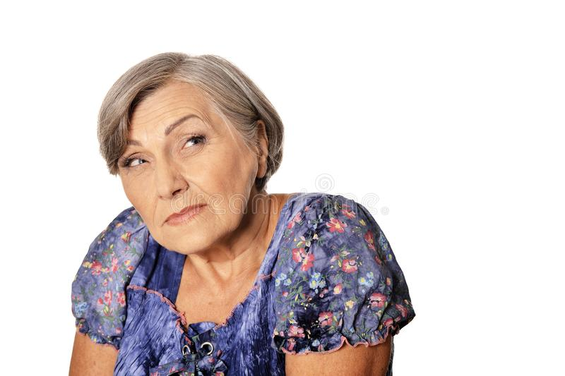 Portrait of suspicious beautiful senior woman posing isolated on white background royalty free stock images