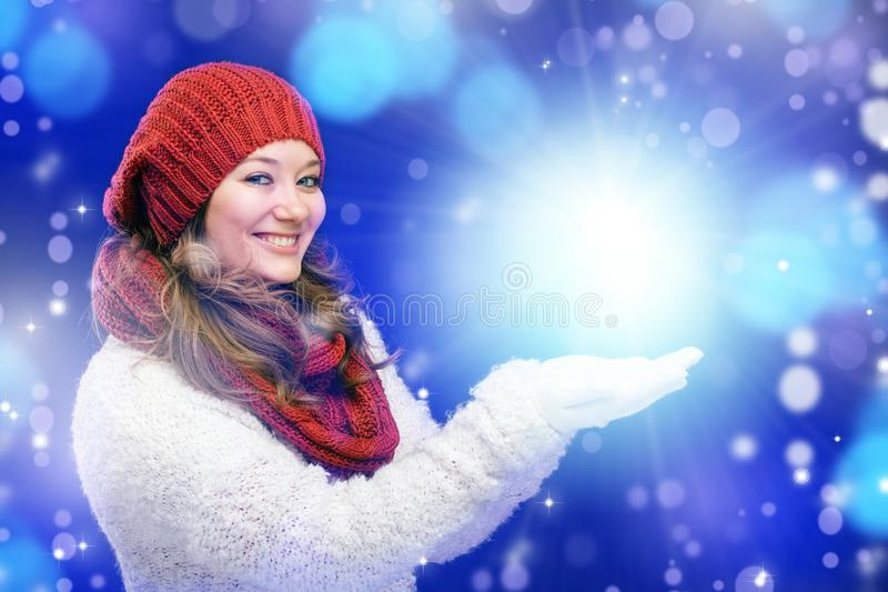Portrait of a sweet girl with a red scarf Christmas, close-up.  stock photography