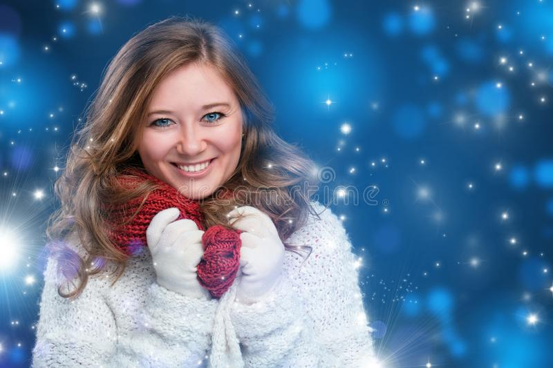 Portrait of a sweet girl with a red scarf Christmas, close-up stock image