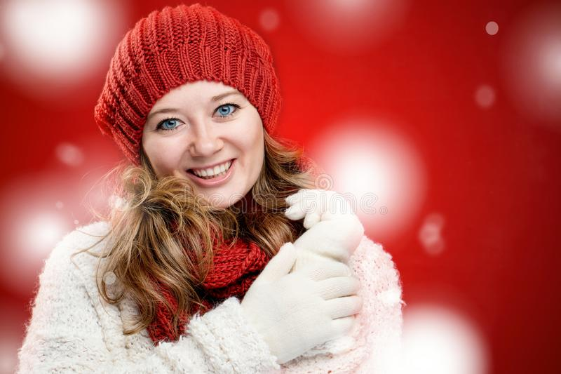 Portrait of a sweet girl with a red scarf Christmas, close-up stock photos