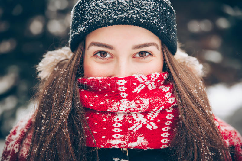 Portrait of a sweet girl with a red scarf Christmas, close-up royalty free stock images