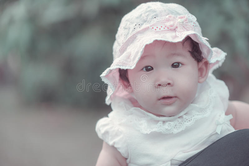 Portrait of sweet little asian baby girl in vintage style. royalty free stock photos