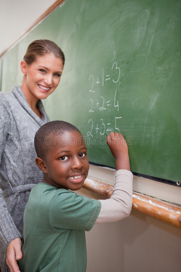 Portrait of a teacher explaining mathematics to a pupil