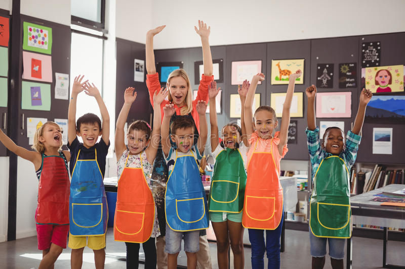 Portrait of teacher and schoolkids having fun. In drawing class royalty free stock photography