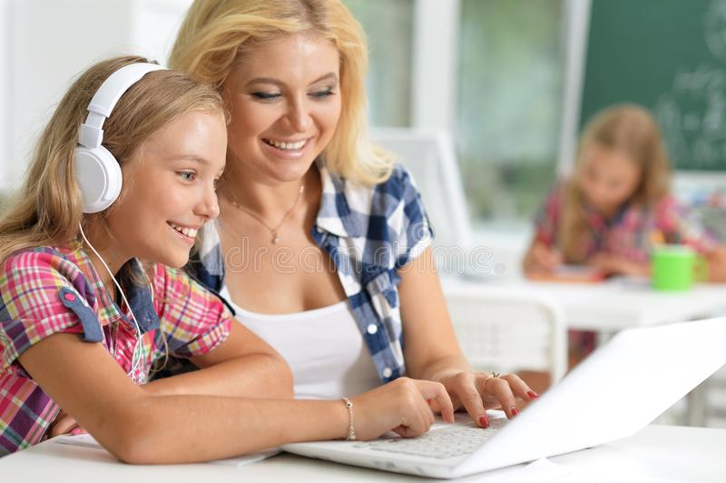 Teacher with two schoolgirls royalty free stock photography
