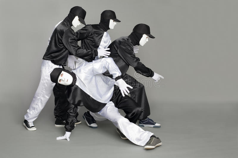 Portrait of a team of young break dancers royalty free stock photography