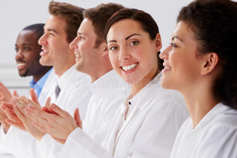Portrait Of Technician And Colleagues In Laboratory Clapping royalty free stock image